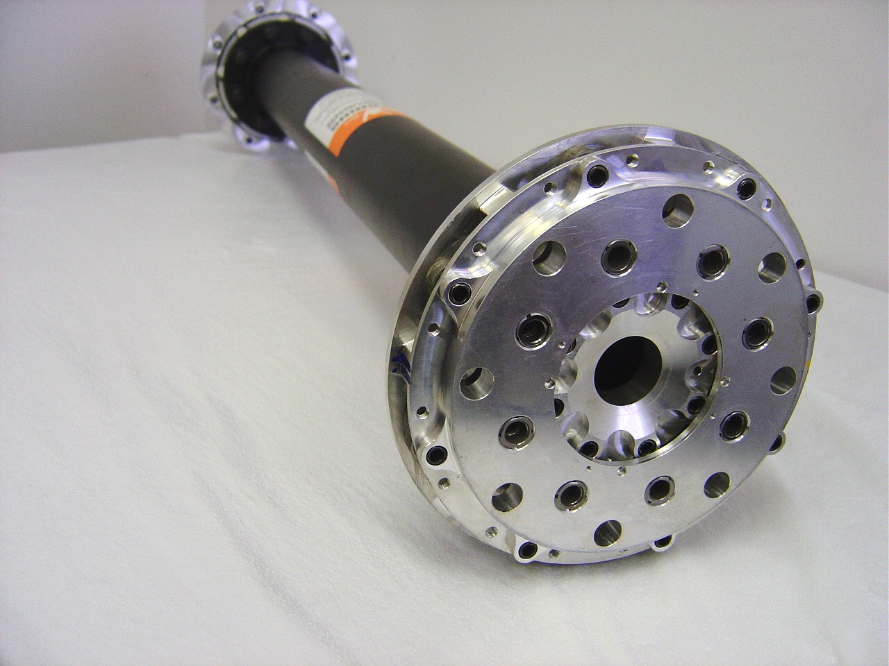 High speed coupling with machined weight reduction